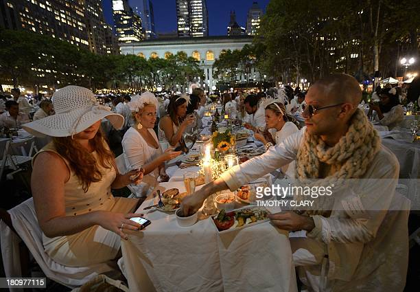 Guests are seated for dinner at Bryant Park September 18 2013 during the annual Diner en Blanc the worlds only viral culinary event a chic secret...