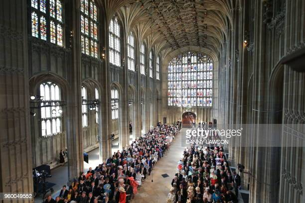 Guests are seated inside St George's Chapel Windsor Castle in Windsor on May 19 2018 for the wedding ceremony of Britain's Prince Harry Duke of...