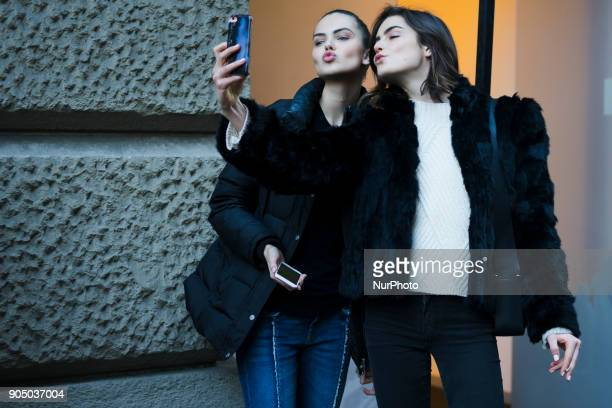 Guests are seen after DAKS fashion show during Milan Men's Fashion Week Fall/Winter 2018/19 on January 14 2018 in Milan Italy