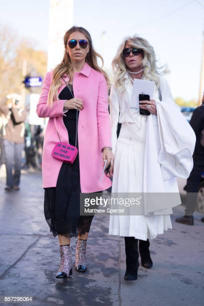 Guests are seen attending Chanel during Paris Fashion Week wearing Chanel on October 3 2017 in Paris France