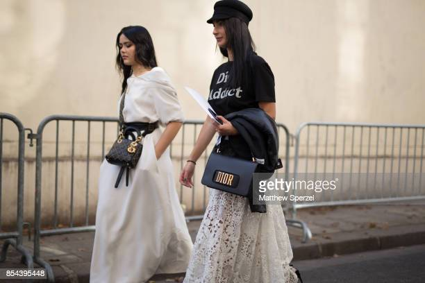 Guests are seen attending Christian Dior during Paris Fashion Week wearing Dior on September 26 2017 in Paris France