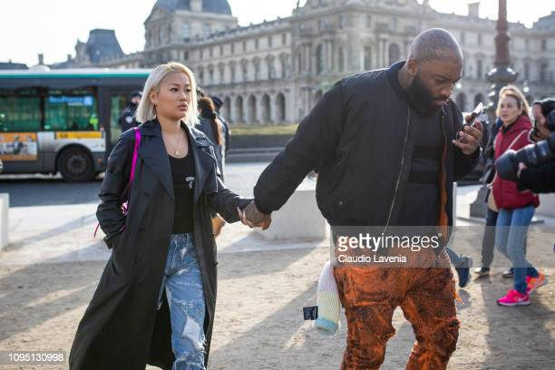 Guests are seen in the streets of Paris before the OffWhite show on January 16 2019 in Paris France