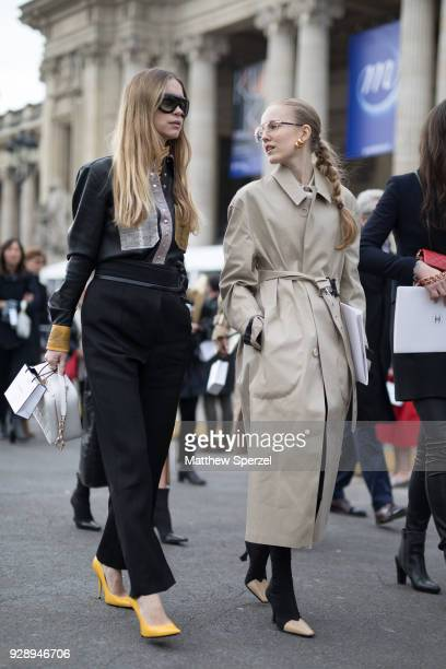 Guests are seen on the street attending Chanel during Paris Women's Fashion Week A/W 2018 on March 6 2018 in Paris France