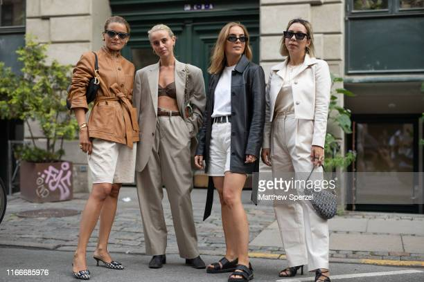 Guests are seen on the street attending Copenhagen Fashion Week SS20 on August 07, 2019 in Copenhagen, Denmark.