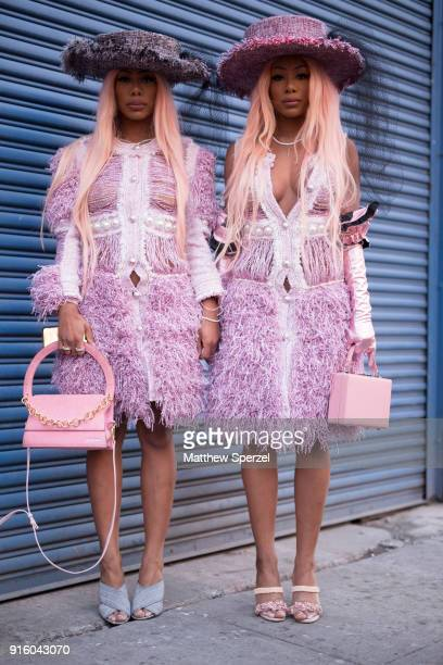 Guests are seen on the street attending Laurence Chico during New York Fashion Week wearing pink and purple matching fringe outfits with hats and...