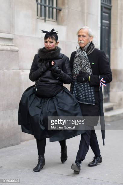 Guests are seen on the street attending Noir Kei Ninomiya during Paris Women's Fashion Week A/W 2018 on March 3 2018 in Paris France