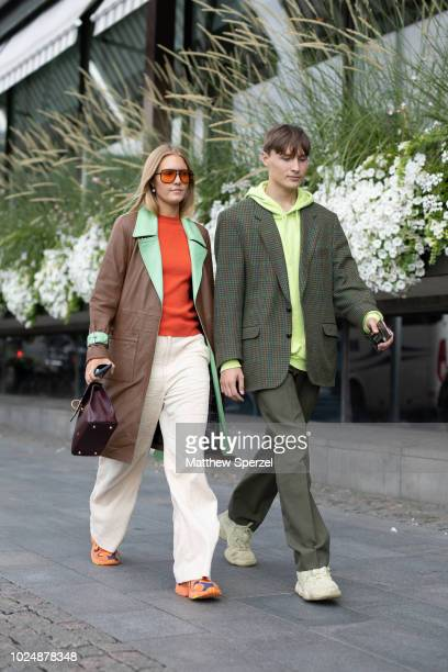 Guests are seen on the street during Fashion Week Stockholm on August 28 2018 in Stockholm Sweden