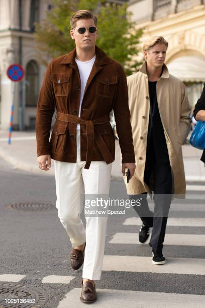 Guests are seen on the street during Fashion Week Stockholm SS19 on August 29 2018 in Stockholm Sweden
