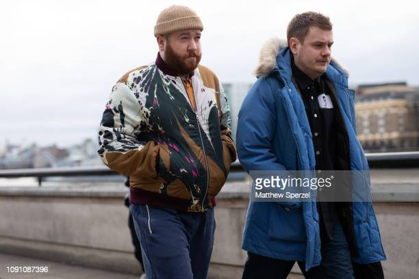 Guests are seen on the street during London Fashion Week Men's January 2019 on January 07 2019 in London England