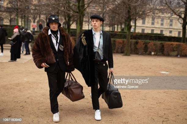 Guests are seen on the street during Men's Paris Fashion Week AW19 on January 20, 2019 in Paris, France.