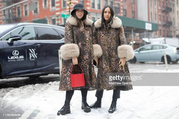 Guests are seen on the street during New York Fashion Week AW19 wearing matching leopard print coats with fur trim on February 12 2019 in New York...