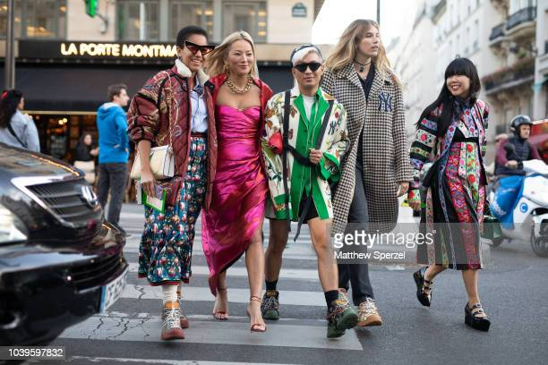 Guests are seen on the street during Paris Fashion Week SS19 wearing Gucci on September 24 2018 in Paris France