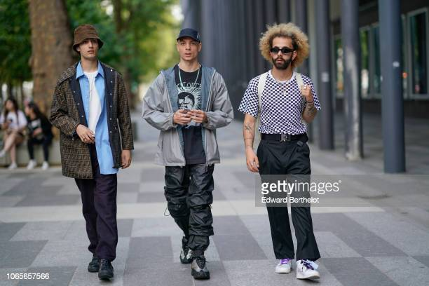 Guests are seen outside Issey Miyake during Paris Fashion Week Menswear SpringSummer 2019 on June 21 2018 in Paris France