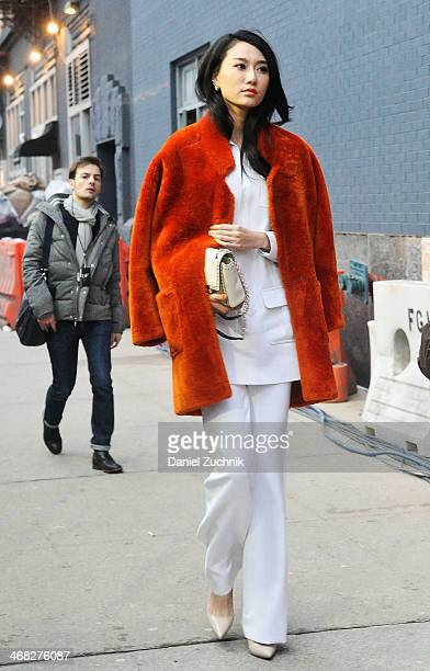 Guests are seen outside the Diane Von Furstenberg show on February 9, 2014 in New York City.