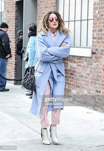 Guests are seen outside the DKNY show on February 15, 2015 in New York City.