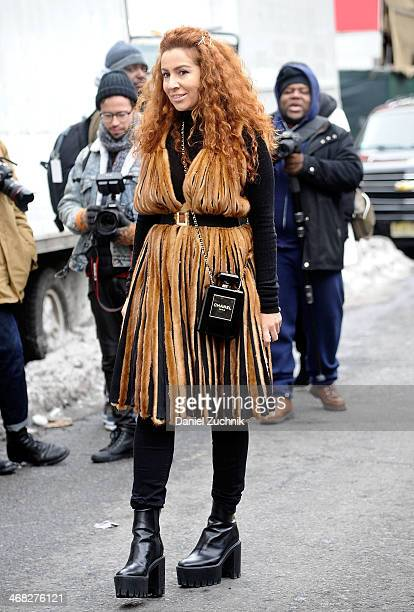 Guests are seen outside the DKNY show on February 9, 2014 in New York City.