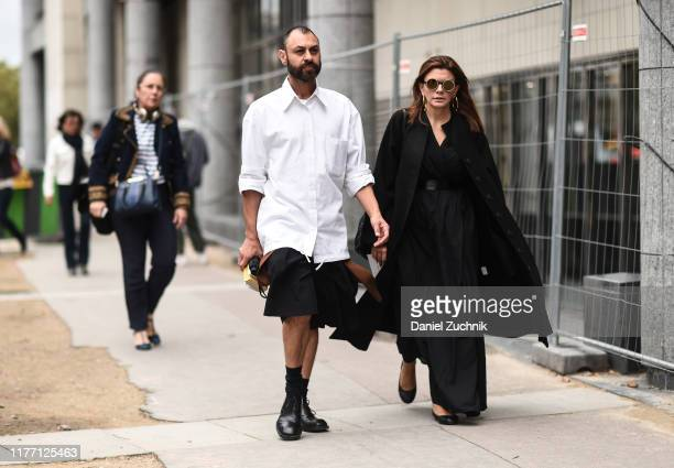 Guests are seen outside the Dries Van Noten show during Paris Fashion Week SS20 on September 25 2019 in Paris France