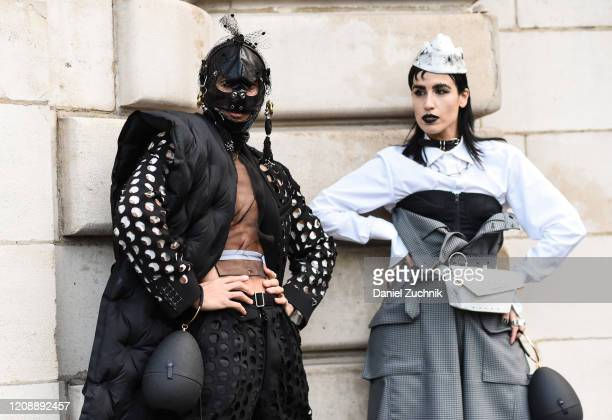 Guests are seen outside the Maison Margiela show during Paris Fashion Week: AW20 on February 26, 2020 in Paris, France.