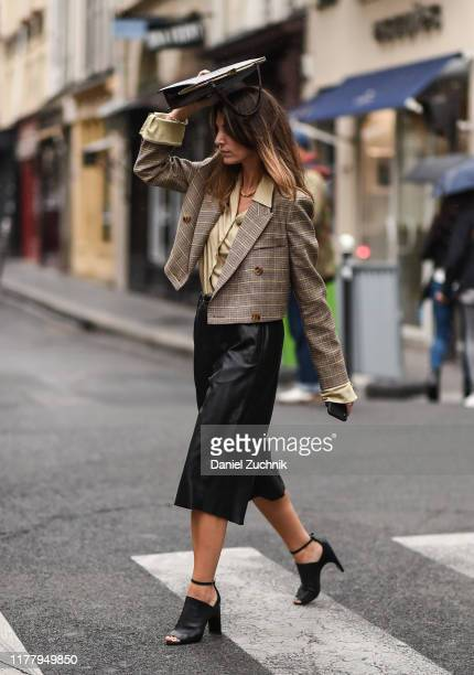 Guests are seen outside the Thom Browne show during Paris Fashion Week SS20 on September 29, 2019 in Paris, France.