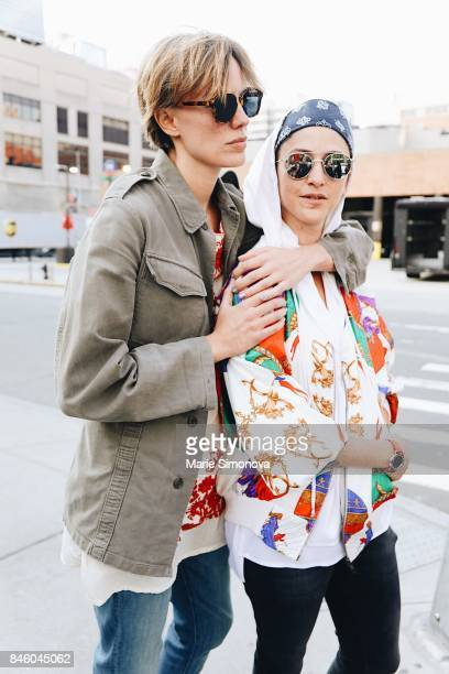 Guests are seen outsude Skylight Clarkson wearing beige jacket and printed bomber jacket on September 11 2017 in New York City