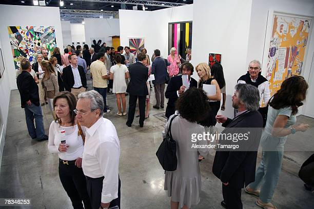 Guests are seen viewing art from the Gagosian Gallery at the Miami Beach Convention Center during day five of Art Basel Miami Beach 2007 on December...
