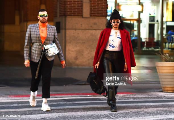 Guests are seen wearing a checkered jacket and red coat with black pants outside the Tanaka show during New York Fashion Week Men's Fall/Winter 2019...