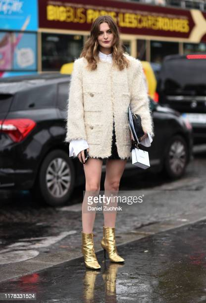 Guests are seen wearing Chanel outside the Chanel show during Paris Fashion Week SS20 on October 1, 2019 in Paris, France.