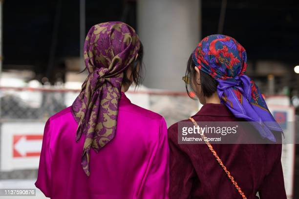 Guests are seen wearing silk floral head scarves during the Amazon Fashion Week TOKYO 2019 A/W on March 22 2019 in Tokyo Japan