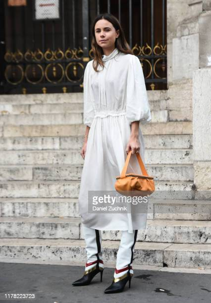 Guests are seen wearing Stella McCartney outside the Stella McCartney show during Paris Fashion Week SS20 on September 30 2019 in Paris France