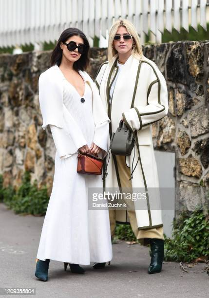 Guests are seen wearing white Loewe outfits outside the Loewe show during Paris Fashion Week: AW20 on February 28, 2020 in Paris, France.