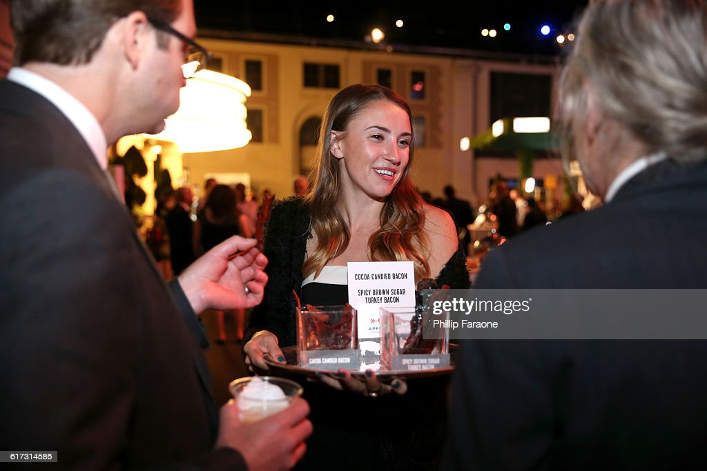 Guests are served bacon at the Environmental Media Association 26th Annual EMA Awards Presented By Toyota, Lexus And Calvert at Warner Bros. Studios on October 22, 2016 in Burbank, California.