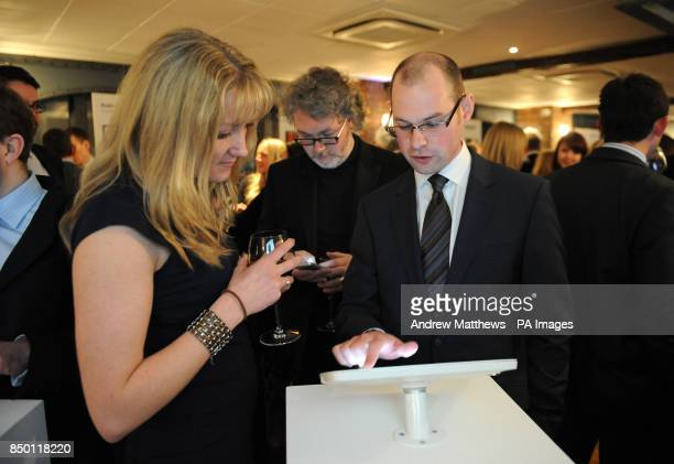 Guests are shown the iPad timeline at the Professional Publishers Association Centenary Opening party at the Skyloft Millbank Tower London