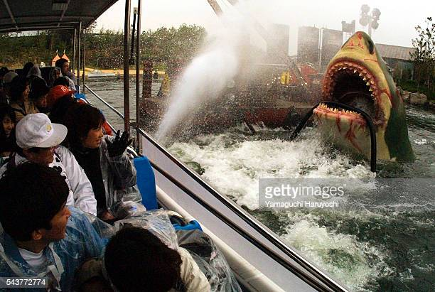 Guests are surprised by Jaws during a press preview of Universal Studios Japan in Osaka The theme park's grand opening day is March 31 2001