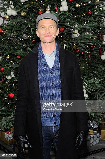 Guests are surprised by Neil Patrick Harris at the the It's Christmas Keep it Real popup at South Street Seaport on December 6 2016 in New York City