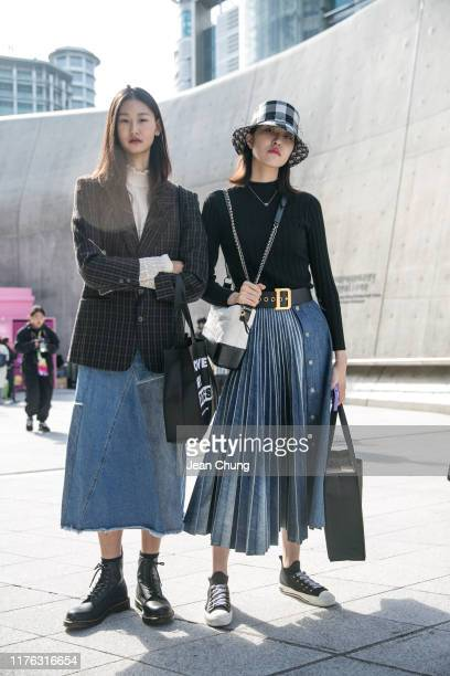 Guests are wearing a striped blazer, denim skirt and Dior bucket hat, belt, and denim skirt seen during the Seoul Fashion Week 2020 S/S at Dongdaemun...