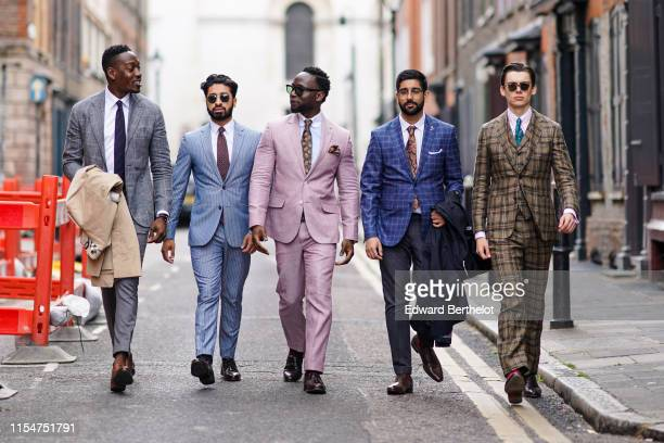 Guests are wearing blazer jackets white shirt tie sunglasses during London Fashion Week Men's June 2019 on June 08 2019 in London England