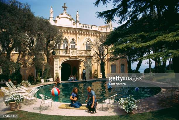 Guests around the pool at the Chateau St Jean owned by Rosemarie Kanzler Marcie Riviere Cap Ferrat France September 1973