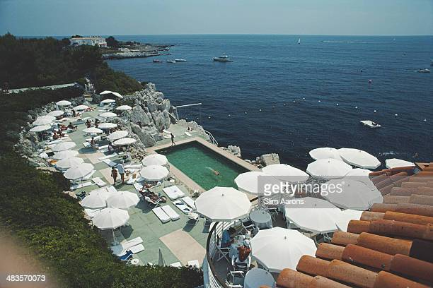Guests around the swimming pool at the Hotel du CapEdenRoc in Antibes on the French Riviera August 1978