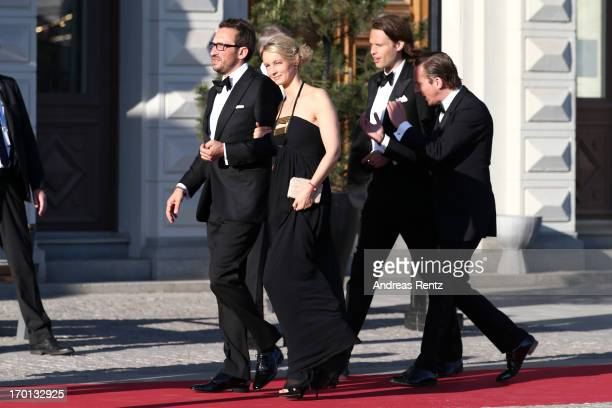 Guests arrive at a private dinner on the eve of the wedding of Princess Madeleine and Christopher O'Neill hosted by King Carl XVI Gustaf and Queen...