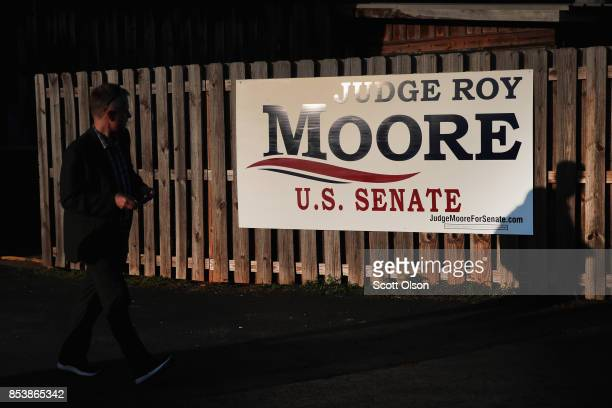 Guests arrive at a rally for Republican candidate for the US Senate in Alabama Roy Moore on September 25 2017 in Fairhope Alabama Moore is running in...