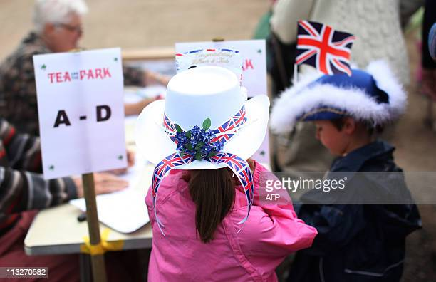 Guests arrive at a Tea in the Park event in Kate Middleton's home village of Bucklebury Berkshire on April 29 2011 AFP PHOTO / CHRIS RATCLIFFE