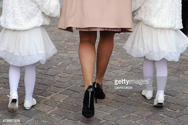 Guests arrive at Sanctuary of Madonna di Montenero before the wedding of Italian singer Andrea Bocelli with Veronica Berti on March 21 2014 in...