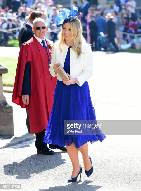 Guests arrive at St George's Chapel at Windsor Castle before the wedding of Prince Harry to Meghan Markle on May 19 2018 in Windsor England