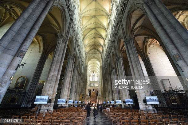 Guests arrive at the Cathedral Basilica of Our Lady in Amiens northern France on August 8 for a ceremony to mark the 100th anniversary of the World...