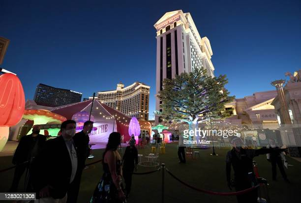 """Guests arrive at the courtyard entrance of the """"Absinthe"""" show at Caesars Palace on the Las Vegas Strip on October 29, 2020 in Las Vegas, Nevada...."""