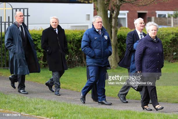 Guests arrive at the Funeral of Manchester City Life President Bernard Halford at St Mary's Church in Manchester on April 10 2019 in Manchester...