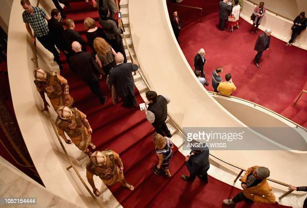 Guests arrive at the Metropolitan Opera at Lincoln Center for the Performing Arts on October 5 2018 in New York City The Metropolitan Opera is...