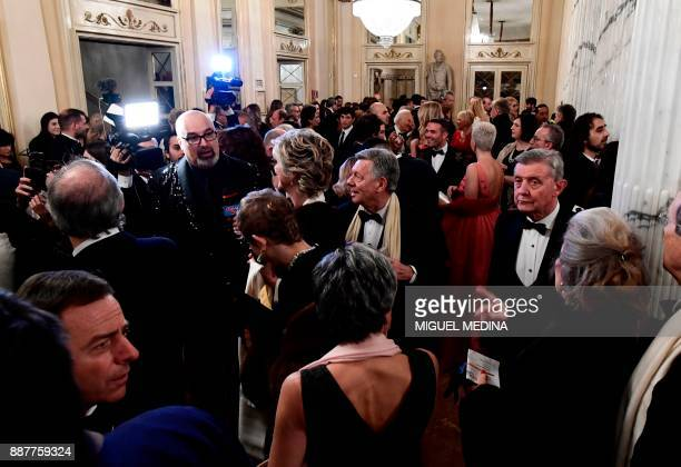 Guests arrive at the Teatro alla Scala opera house for the Premiere of 'Andrea Chénier' of Italian composer Umberto Giordano which opens the season...