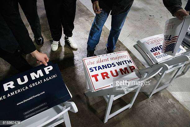 Guests arrive for a rally with Republican presidential candidate Donald Trump at the Central Illinois Regional Airport on March 13, 2016 in...