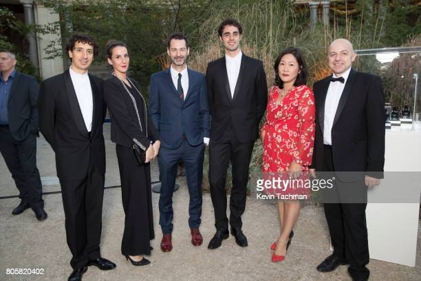 Guests arrive for the amfAR Paris Dinner at Le Petit Palais on July 2 2017 in Paris France